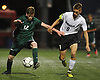 Nick Tagios #9 of Wheatley, right, and John Driscoll of Carle Place battle for possession during the first half of the Nassau County varsity boys soccer Class B final at Hofstra University on Wednesday, Oct. 25, 2017. Tagios scored twice in the second half to lead the Wildcats to a 3-0 win.