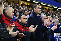 Swansea City manager Paul Clement and Leon Britton of Swansea City and Karl Halabi join in a minutes applause prior to kick off of the Premier League match between Chelsea and Swansea City at Stamford Bridge, London, England, UK. Wednesday 29 November 2017