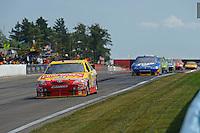 6-8 August, 2010, Watkins Glen, New York USA.Marcos Ambrose (#47) races in second place ahead Kurt Busch (#2)..©2010 F.Peirce Williams, USA.