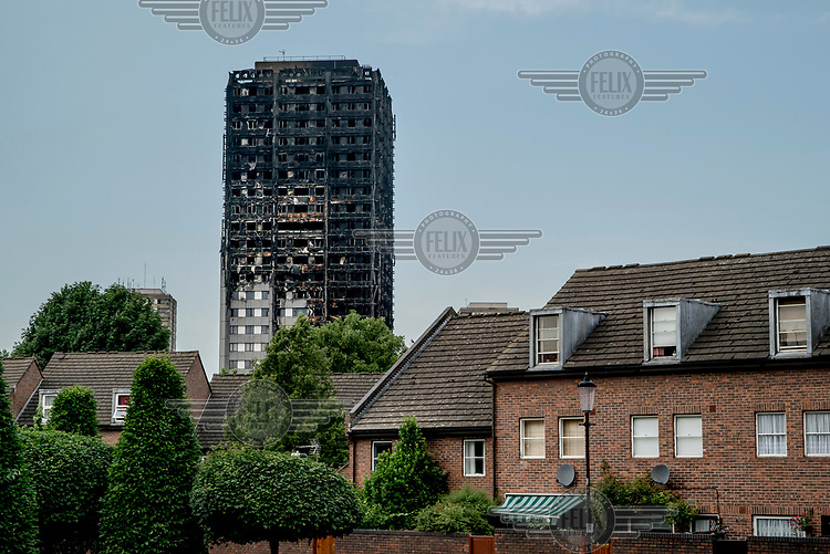 The charred ruins of Grenfell Tower following the fire of 14 June 2017 which rapidly spreaad through the building killing at least 80 people and leaving many more without homes or possessions.