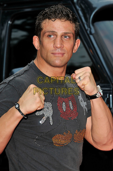 ALEX REID.'The A-Team' UK film premiere at Empire cinema, Leicester Square, London, England 27th July 2010.half length grey gray t-shirt hands fists mickey mouse wedding ring .CAP/PL.©Phil Loftus/Capital Pictures.