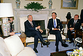 United States President George H.W. Bush, right, meets with President Mikhail Gorbachev of the Union of Soviet Socialist Republics, left, in the Oval Office of the White House in Washington, DC on Thursday, May 31, 1990.  It was the start of three days of talks between the two leaders.<br /> Credit: Ron Sachs / CNP