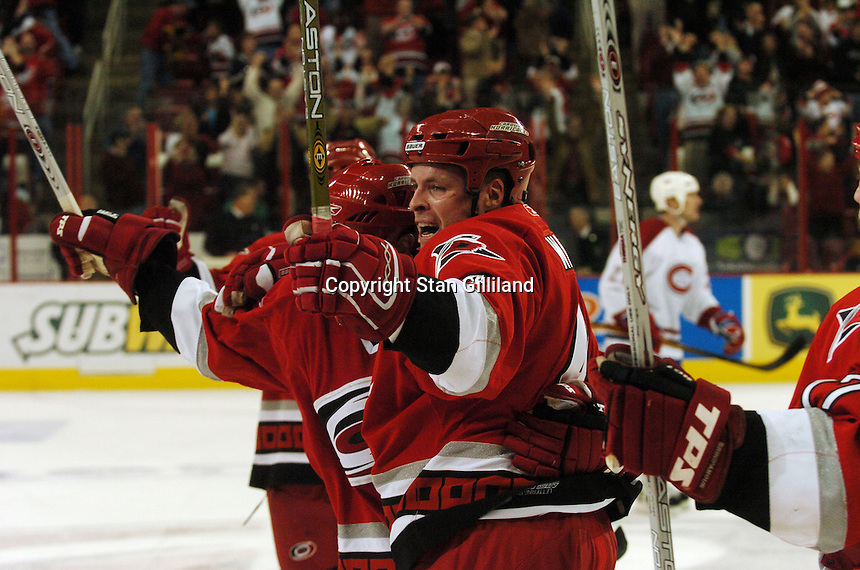 Carolina Hurricanes' defenseman Aaron Ward, center, celebrates his last second goal against the Montreal Canadiens Saturday, Dec. 31, 2005 in Raleigh, NC. Carolina won 5-3.