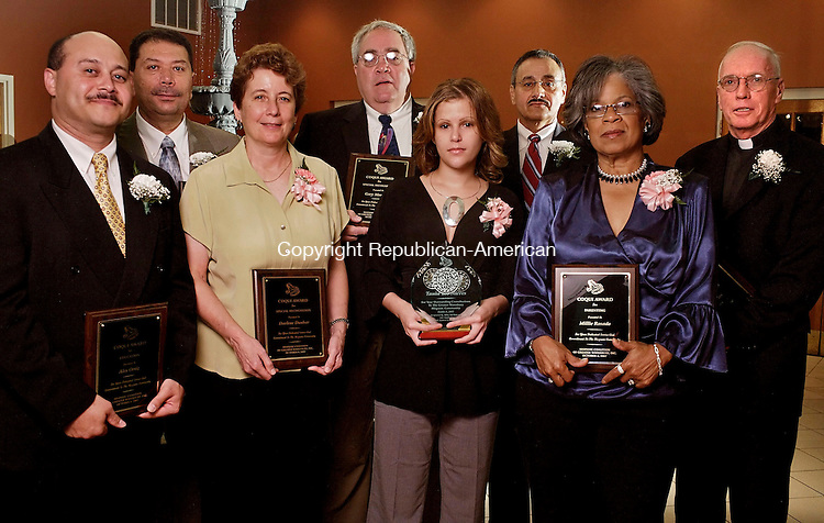 WATERTOWN, CT--06 October 07--100607TJ07 - Alex Ortiz, from left, Education Award recipient, Hilario Huertas, Community Service Award recipient, Darlene Dunbar, special recognition recipient, Gary Montano, special recognition recipient, Tania Lee Nieves, recipient of the Bianca Hernandez Melendez Scholarship, Remi Acosta, Leadership Award recipient, Millie Rosado, Parent Award recipent, and Fr. Kevin Gray, Spirituality Award recipient, pose during the Hispanic Coalition of Greater Waterbury Inc.'s Coqui Awards dinner at Grand Oak Villa in Watertown, Conn., on Saturday, October 6, 2007. T.J. Kirkpatrick/Republican-American