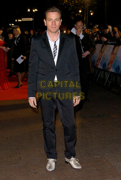 "EWAN McGREGOR.""Miss Potter"" World Film Premiere.Empire cinema, Leicester Square.London, England  3rd December 2006.full length black suit striped tie silver shoes.CAP/CAN .©Can Nguyen/Capital Pictures"