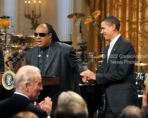 "Washington, D.C. - February 25, 2009 -- Stevie Wonder makes remarks as United States President Barack Obama looks on during the taping of ""Stevie Wonder In Performance at the White House: The Library of Congress Gershwin Prize"" to showcase an evening of celebration at the White House in honor of musician Stevie Wonder's receipt of the Library of Congress Gershwin Prize for Popular Song in the East Room of the White House in Washington, D.C. on Wednesday, February 25, 2009..Credit: Ron Sachs / Pool via CNP"