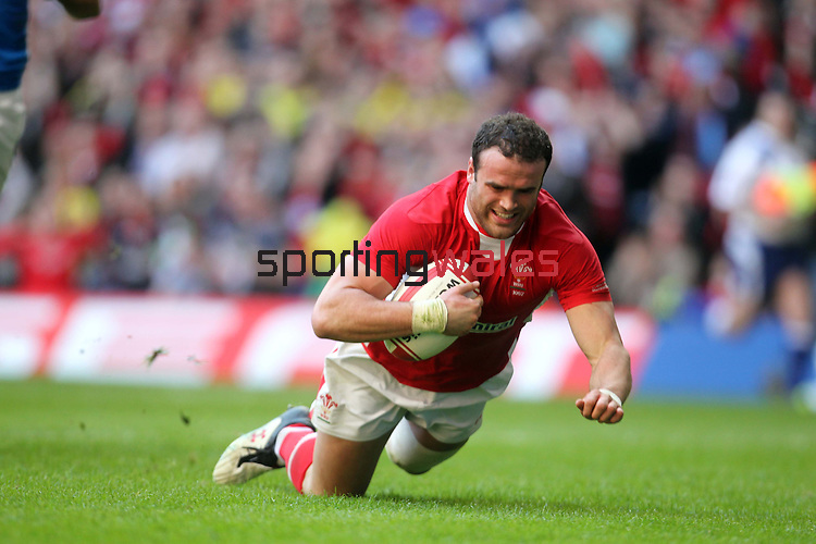 Jamie Roberts dives over to score the first try of the match for Wales..2012 RBS 6 Nations.Wales v Italy.Millennium Stadium..10.03.12.Credit: STEVE POPE-Sportingwales
