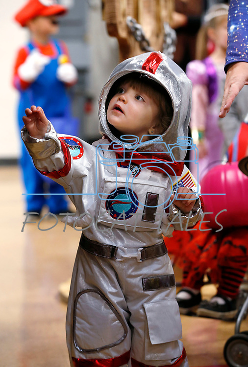 Fern Reynolds, 2, trick-or-treats at the Carson City Boo-nanza event, in Carson City, Nev., on Tuesday, Oct. 30, 2018. <br /> Photo by Cathleen Allison/Nevada Momentum