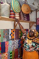 Stone Town, Zanzibar, Tanzania.  Basket Maker in her Shop.