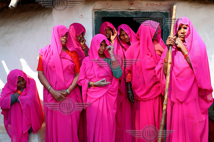 A group of women known as The Gulabi Gang (The Pink Gang). Fed up with abusive husbands and corrupt government officials, Sampat Pal Devi, a mother of five and former government health worker, founded the group in 2006. They have been known to beat abusive husbands and prevented several child marriages.