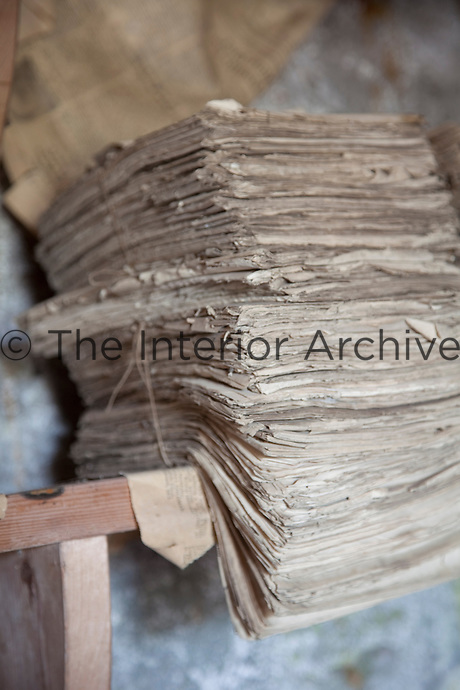 A bundle of decaying papers tied up with string in the darkroom