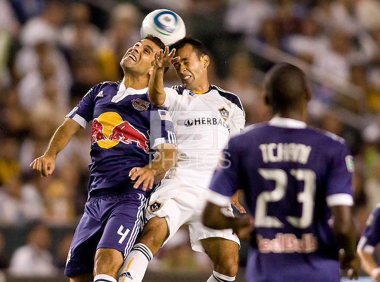 Midfielder Rafael Marquez of the New York Red Bullsgoes head to head with LA Galaxy midfielder Juninho. The New York Red Bulls beat the LA Galaxy 2-0 at Home Depot Center stadium in Carson, California on Friday September 24, 2010.