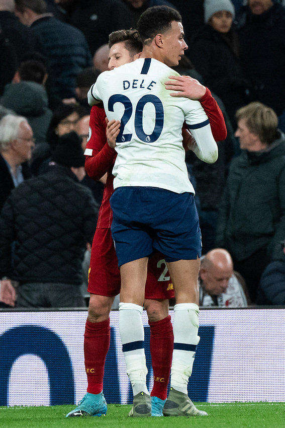 Tottenham's Dele Alli and Liverpool's Adam Lallana embrace after the final whistle<br /> <br /> Photographer Stephanie Meek/CameraSport<br /> <br /> The Premier League - Tottenham Hotspur v Liverpool - Saturday 11th January 2020 - Tottenham Hotspur Stadium - London<br /> <br /> World Copyright © 2020 CameraSport. All rights reserved. 43 Linden Ave. Countesthorpe. Leicester. England. LE8 5PG - Tel: +44 (0) 116 277 4147 - admin@camerasport.com - www.camerasport.com