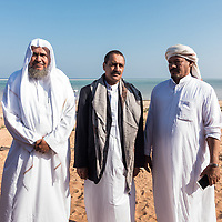 Dec. 31, 2014 - Socotra, Yemen. Three tourists pose for a photograph in Detwah. Socotra draws very few tourists, the last few years Socotra as averaged about 3000 tourists a year, with a fall in 2014 due to political instability on the main land. ©Nicolas Axelrod / Ruom © Nicolas Axelrod / Ruom