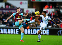 Burnley's Ashley Barnes vies for possession with Swansea City's Kyle Naughton<br /> <br /> Photographer Ashley Crowden/CameraSport<br /> <br /> The Premier League - Swansea City v Burnley - Saturday 10th February 2018 - Liberty Stadium - Swansea<br /> <br /> World Copyright &copy; 2018 CameraSport. All rights reserved. 43 Linden Ave. Countesthorpe. Leicester. England. LE8 5PG - Tel: +44 (0) 116 277 4147 - admin@camerasport.com - www.camerasport.com