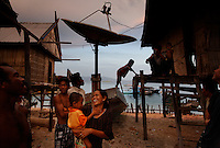 Village of Pulau Misa has some nets for live reef fish and also photos in the town itself.  Diver and trip organizer is Graham Abbott (+6281338673026).  Scientists are Yvonne Sadovy, Pat Colin and Santi from Indo govt agency LIPPY..Initially reef fish only came from the South China Sea, but transport developed and fish now come from all over S.E. Asia.  The whole reef fish trade crashed with the 97-98 HK stock market crash.  LRF trade is directly linked to economy.  With China coming online financially the trade is booming.  These fish are often used for celebratory meals in Hong Kong, but in Guangzhou the fish are so cheap and the apartments are so small that many people eat out...  And the stereotype is that there is lots of food left on the table.  Often a fish is popular because of its color... more than its taste.