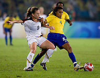 USWNT forward (8) Amy Rodriguez fights for the ball with Brazilian defender (4) Tania while playing for the gold medal at Workers' Stadium.  The USWNT defeated Brazil, 1-0, during the 2008 Beijing Olympic final in Beijing, China.