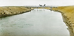 Jerome ID:  Horse-drawn carriage traveling over the irrigation canal - 1909.  Brady Stewart and three friends went to Idaho on a lark from 1909 thru early 1912.  As part of the Mondell Homestead Act, they received a grant of 160 acres north of the Snake River.  Brady Stewart photographed the adventures of farming along with the spectacular landscapes. To give family and friends a better feel for the adventure, he hand-color black and white negatives into full-color 3x4 lantern slides.  The Process:  He contacted a negative with another negative to create a positive slide.  He then selected a fine brush and colors and meticulously created full color slides.