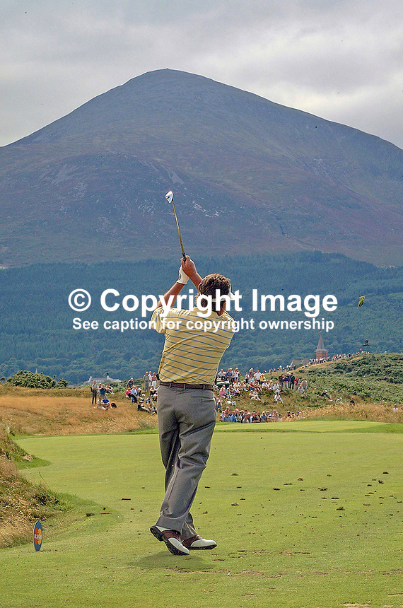 Ian Stanley, professional golfer, Australia, plays a shot with Slieve Donard, part of the Mountains of Mourne, N Ireland, UK, in the distance. Taken at British Seniors Open Championship at Royal County Down, Newcastle, N Ireland. Ref: 200107293050.<br />
