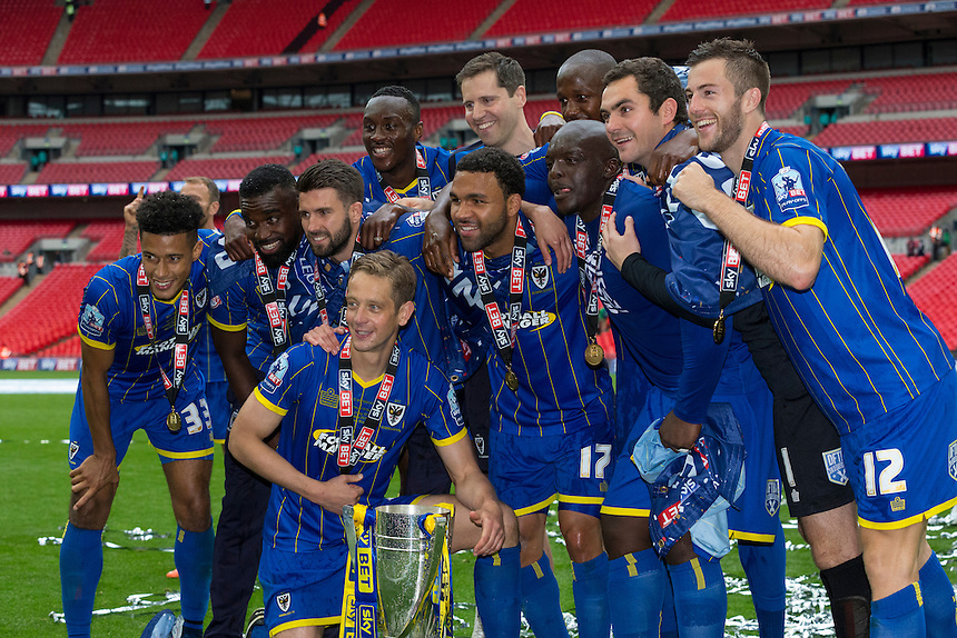 AFC Wimbledon players pose with the winner's trophy<br /> <br /> Photographer Craig Mercer/CameraSport<br /> <br /> Football - The Football League Sky Bet League Two Play-Off Final - AFC Wimbledon v Plymouth Argyle - Monday 30 May 2016 - Wembley Stadium - London<br /> <br /> World Copyright &copy; 2016 CameraSport. All rights reserved. 43 Linden Ave. Countesthorpe. Leicester. England. LE8 5PG - Tel: +44 (0) 116 277 4147 - admin@camerasport.com - www.camerasport.com