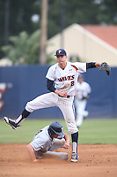 Hutton Moyer #2 of the Pepperdine Waves avoids Eric Urry #4 of the BYU Cougars while throwing to first base during a game at Eddy D. Field Stadium on April 10, 2014 in Malibu, California. BYU defeated Pepperdine, 1-0. (Larry Goren/Four Seam Images)