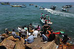 Palestinian activists ride fishing boats as they protesting and perhaps trying to breach Israel's naval blockade on Gaza, setting to sail from Gaza City harbour towards Europe on May 29, 2018. Palestinians in Gaza are planning to break the Israeli blockade of the enclave by sending out two boats carrying medical patients. Organisers say the boats, which will carry people needing medical care, are a message that Palestinians will not accept Israel's blockade. The Gaza Strip has been under Israeli blockade for more than a decade severely restricting the flow of goods into the enclave, including food and medical supplies. Patients who require medical attention outside Gaza have been unable to leave the territory because of the blockade. Photo by Ashraf Amra