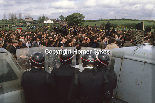 RUC at Hunger striker Francis Hughes funeral 1981 Bellaghy, in County Londonderry, Northern Ireland.<br /> <br /> IRA hunger striker Francis Hughes funeral in Bellaghy, in County Londonderry, May 1981. Hughes was the second person, after Bobby Sands, to die in May 1981 during a hunger strike at the Maze (Long Kesh) prison. Following his capture in February 1980, Hughes was tried for, and found guilty of, the murder of one British Army soldier and the wounding of another in the incident which led to his capture, as well as a series of gun and bomb attacks over a six-year period. He was sentenced to a total of 83 years in prison.