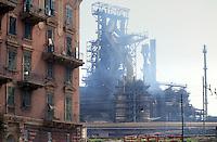 - Genoa Cornigliano, installations of steel factory ILVA behind popular houses....- Genova, gli impianti delle acciaierie ILVA di Cornigliano dietro case popolari
