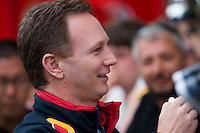March 15, 2014: Christian Horner from the Infiniti Red Bull Racing team signs autographs prior to practice session three at the 2014 Australian Formula One Grand Prix at Albert Park, Melbourne, Australia. Photo Sydney Low.
