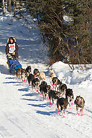 Musher Cain Carter on Long Lake at the Re-Start of the 2011 Iditarod Sled Dog Race in Willow, Alaska.