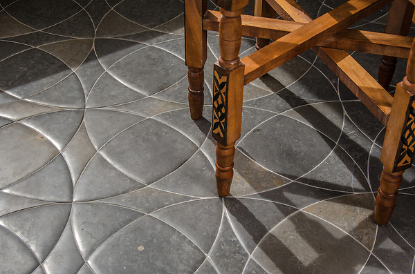 Zazen Grande, a waterjet stone mosaic, shown in Venetian honed Cavern, is a design by Paul Schatz and is part of the Palazzo™ collection by New Ravenna.
