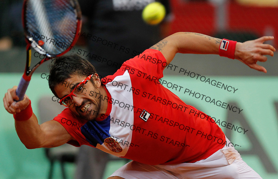 Tennis Tenis<br /> Davis Cup semifinal polufinale<br /> Serbia v Canada<br /> Janko Tipsarevic v Milos Raonic<br /> Janko Tipsarevic returns the ball<br /> Beograd, 13.09.2013.<br /> foto: Srdjan Stevanovic/Starsportphoto &copy;