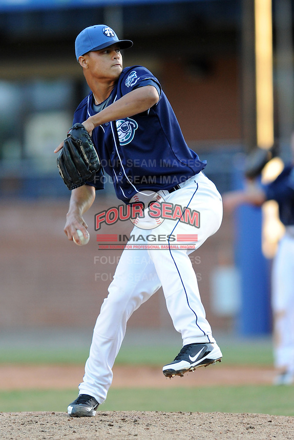 Asheville Tourists pitcher Jefri Hernandez #14 delivers at a pitch  during a game between the Delmarva Shorebirds and the Asheville Tourists at McCormick Field, Asheville, North Carolina April 7, 2012. The Tourists won game one of a double header  8-4  (Tony Farlow/Four Seam Images)..