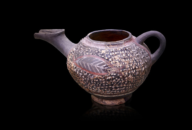 """Minoan Kamares Ware beak spouted """"teapot"""" with extended spout and  leaf polychrome decorations, Kamares Sacred Cave 1900-1700 BC; Heraklion Archaeological  Museum, black background.<br /> <br /> This style of pottery is named afetr Kamares cave where this style of pottery was first found"""
