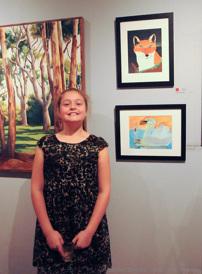 "Artist Arwen Schoolcraft with her acrylic painting ""Fox"" at Rectangle Gallery's Gala Opening for Youth Art Exhibition during Centralia, Washington's Third Thursday on October 20, 2016."