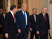United States President Donald J. Trump (C) walks with Senate Majority Leader Mitch McConnell (R), R-KY, and Chairman of the Senate Republican Policy Committee John Barrasso (L), R-WY, as they make their way to a meeting with the Senate Republican caucus, at the U.S. Capitol Building on November 28, 2017 in Washington, D.C. <br /> Credit: Kevin Dietsch / Pool via CNP