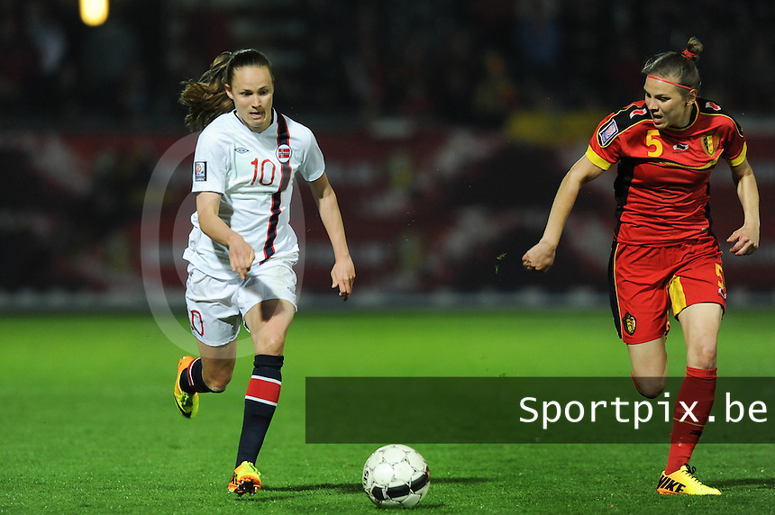 20140410 - LEUVEN , BELGIUM : Norwegian Caroline Hansen (10) pictured Belgian Lorca Van De Putte (right) during the female soccer match between Belgium and Norway, on the seventh matchday in group 5 of the UEFA qualifying round to the FIFA Women World Cup in Canada 2015 at Stadion Den Dreef , Leuven . Thursday 10th April 2014 . PHOTO DIRK VUYLSTEKE