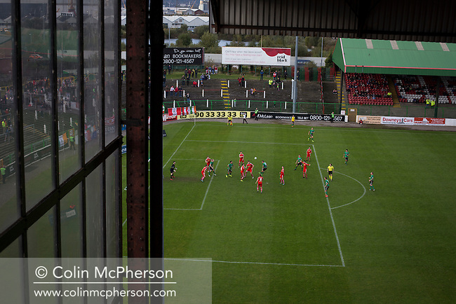 The home team pressing for a winner during the second-half at The Oval, Belfast as Glentoran host city-rivals Cliftonville in an NIFL Premiership match. Glentoran, formed in 1892, have been based at The Oval since their formation and are historically one of Northern Ireland's 'big two' football clubs. They had an unprecendentally bad start to the 2016-17 league campaign, but came from behind to win this fixture 2-1, watched by a crowd of 1872.