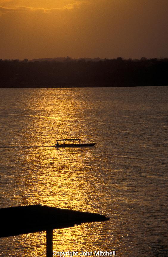 Launch crossing lake Peten Itza at sunset, Flores, El Peten, Guatemala