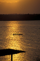 Launch crossing lake Peten Itza at sunset, Flores, El Peten, Guatemala