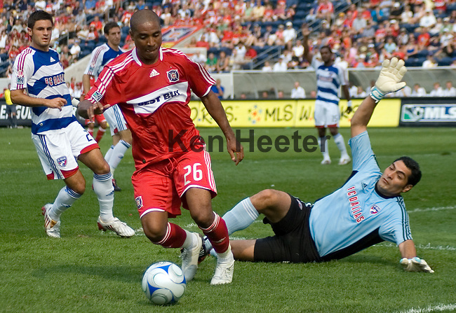 Andy Herron Chicago Fire fakes a shot on goal at Dario Sala of FC Dallas only to move to the outside for a better look.