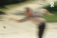 French boules player throwing boule (defocussed) (Licence this image exclusively with Getty: http://www.gettyimages.com/detail/200387428-001 )