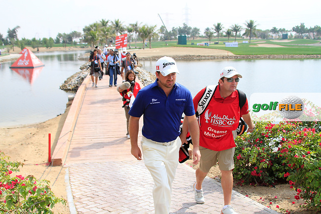Graeme McDowell makes his way to the 7th teebox during Day 3 Saturday of the Abu Dhabi HSBC Golf Championship, 22nd January 2011..(Picture Eoin Clarke/www.golffile.ie)