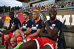 15 June 2016: New England's Kei Kamara (SLE) (right) sits on the bench with (from right) Lee Nguyen, Steve Neumann, and Sambinha (POR). The Carolina RailHawks hosted the New England Revolution at WakeMed Stadium in Cary, North Carolina in a 2016 Lamar Hunt U.S. Open Cup fourth round game.