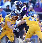 BROOKINGS, SD - OCTOBER 26:  T.J. Lalley #33 and R. C. Kilgore #42 from South Dakota State University double team for a tackle on Evan Williams #8 from Northern Iowa in the third quarter of their game Saturday afternoon at Coughlin Alumni Stadium in Brookings. (Photo by Dave Eggen/Inertia)