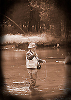 Retired man fly fishing