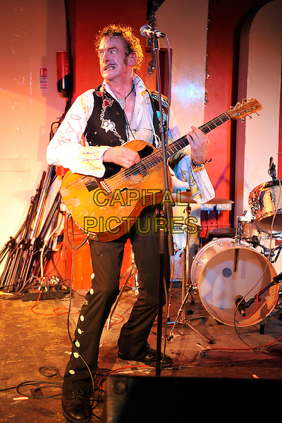 ED TUDOR POLE.performs on stage at the 100 Club,  London, England, UK, .29th December 2010..music gig concert live on stage guitar playing full length white shirt black waistcoat badges trousers buttons funny .CAP/MAR.© Martin Harris/Capital Pictures.