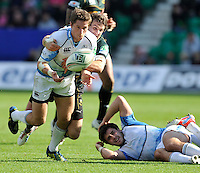 Northampton, England.Henry Pyrgos of Glasgow Warriors tackled by Lee Dickson of Northampton Saints during the Heineken Cup Pool 4 match between Northampton Saints and Glasgow Warriors at Franklin's Gardens on October 14, 2012 in Northampton, England.