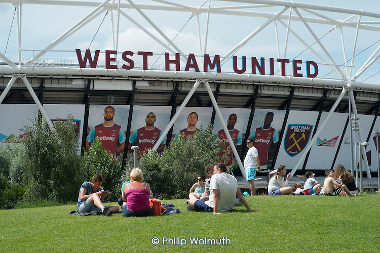 Families by the London 2012 Stadium, Queen Elizabeth Olympic Park, Stratford.  The stadium is now home to West Ham United football club.