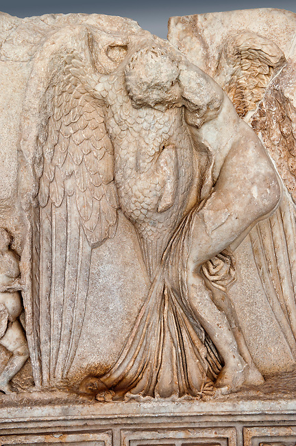 Photo of Roman releif sculpture of Zeus & Leda, Aphrodisias, Turkey, Images of Roman art bas releifs. Buy as stock or photo art prints. Zeus disguised as a swan assaults the Spartan princess Leda. The bird stands on the tips of its outspread wings and presses its webbed feet onto the thigh of the stuggling Leda. The swan is supported by a small Eros. From this encounter came a large egg from which was born Helen and the Dioskouroi twins, Kastor and Polydeukes. Cut Out